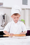 Happy little chef making homemade pizza Stock Photography