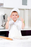 Happy little chef making homemade pizza Stock Photos