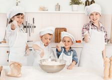 Happy little chefs preparing dough in the kitchen Royalty Free Stock Photography