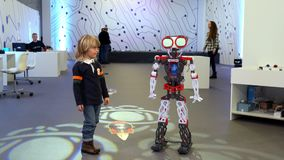Happy Little Child And Big Robot On Robotics Festival Stock Photography