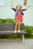 Happy little child, blonde toddler girl jumping Stock Photo
