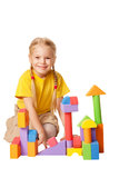 Happy little child is constructing houses Royalty Free Stock Image