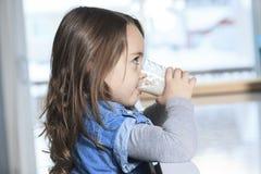 Happy little child drinking milk on a kitchen Stock Photo