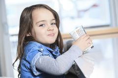 Happy little child drinking milk on a kitchen Stock Photography