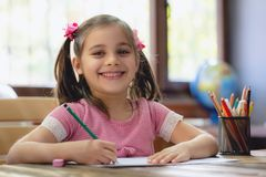 Happy Little Child Girl Drawing Picture stock image