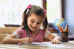 Happy Little Child Girl Drawing Picture stock images