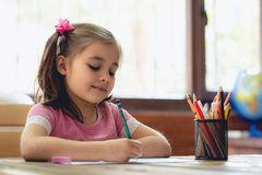 Happy Little Child Girl Drawing Picture royalty free stock images