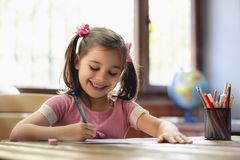 Happy Little Child Girl Drawing Picture royalty free stock photos