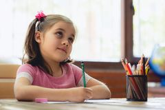 Happy Little Child Girl Drawing Picture stock photos