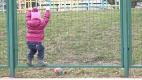 Happy Little Child, Girl  Having fun on the Playground Jumping on the Net. 4K UltraHD, UHD stock footage