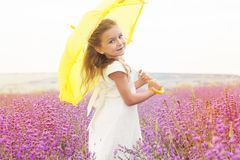 Happy little child girl in lavender field with Royalty Free Stock Images