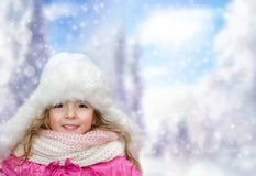 Happy little child girl outdoors on winter bakground,empty space Stock Photos