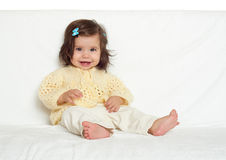 Happy little child girl sit on white towel, happy emotion and face expression Royalty Free Stock Image