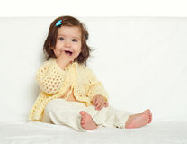 Happy little child girl sit on white towel, happy emotion and face expression, yellow toned Royalty Free Stock Photo