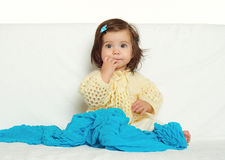 Happy little child girl sit on white towel, happy emotion and face expression, yellow toned Royalty Free Stock Photography