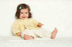 Happy little child girl sit on white towel, happy emotion and face expression, yellow toned Royalty Free Stock Images