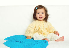 Happy little child girl sit on white towel, happy emotion and face expression, yellow toned Stock Images