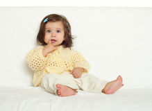 Happy little child girl sit on white towel, happy emotion and face expression, yellow toned Royalty Free Stock Image