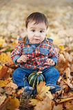 Happy little child holding pumpkin. trick or treat royalty free stock images