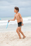 Happy little child kid boy playing beachball Stock Image