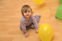 Happy little child playing with balloons. Stock Images