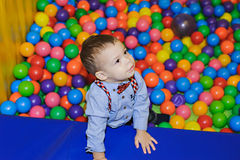 Happy little child playing at colorful plastic balls playground Royalty Free Stock Photos