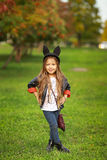 Happy little child posing for the camera, baby girl laughing and playing in the autumn on the nature walk outdoors. Stock Photos