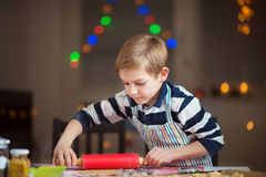 Happy little child preparing cookies for Christmas and New Year Royalty Free Stock Photography