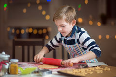 Happy little child preparing cookies for Christmas and New Year Royalty Free Stock Images