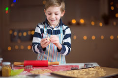 Happy little child preparing cookies for Christmas and New Year Stock Photo