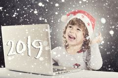 Happy little child with Santa hat royalty free stock photo