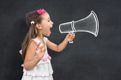 Happy Little Child Schoolgirl Makes Announcement. Call for Back To School royalty free stock image