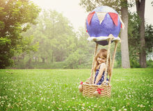 Happy Little Child Sitting in Hot Air Balloon Stock Images