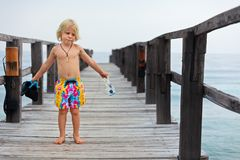 Child with mask, fins going to snorkel in tropical sea royalty free stock image