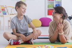Happy child and school counselor royalty free stock photos