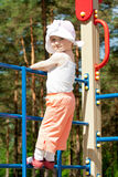 Happy little child on top of a high ladder. Outdoors Royalty Free Stock Images