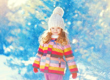 Happy little child walking in winter over snow Royalty Free Stock Images