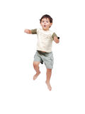 Happy little child in white clothes is jumping iso Royalty Free Stock Photos