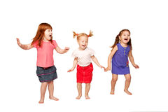 Happy little children dancing and jumping Royalty Free Stock Image