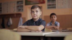 Happy little children in elementary school. Boys and girls study. Children raise hand up.  stock video