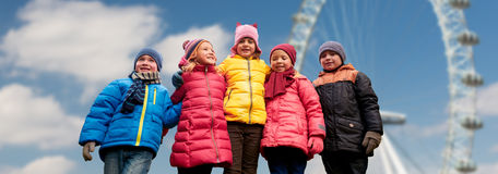 Happy little children faces over ferry wheel Stock Images