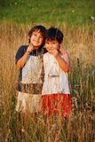 Happy little children in grass Royalty Free Stock Photos