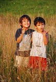 Happy little children in grass Stock Photos