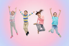 Happy little children jumping in air Stock Photo