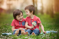 Happy little children, lying in the grass, barefoot, daisies aro royalty free stock photo