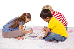 Happy little children painting on the floor Royalty Free Stock Photography