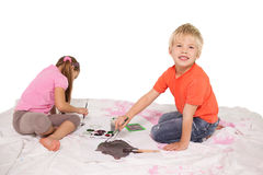 Happy little children painting on the floor Stock Image