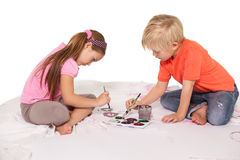 Happy little children painting on the floor Royalty Free Stock Image