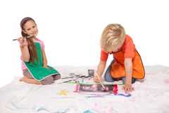 Happy little children painting on the floor Royalty Free Stock Photos