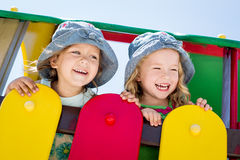Happy little children on the playground Royalty Free Stock Photos
